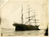 A three-masted sailing bark run aground south