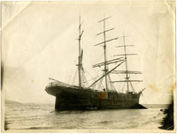 A three-masted sailing bark run aground south