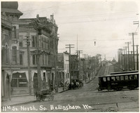 11th St. North, So. Bellingham - Storefronts, horse-drawn carts, and trolley car at corner of 11th Street and Harris Avenue