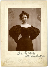 Studio portrait of young woman Rita Christopher in formal Victorian-style dress
