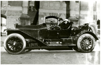 Mary Bourque and Ned Larrabee in fancy early model convertible