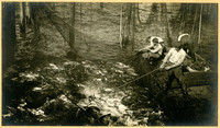 Four men on a scow surrounded by fish traps, brailing a net full of salmon