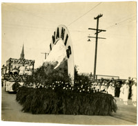 The Kiwanis float in the shape of Mt. Baker, adorned with tulips and greenery, in the Whatcom County Tulip Festival parade
