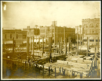 Construction site of YWCA building designed by Carl Gould, located at corner of Maple and Forest streets, Bellingham, WA