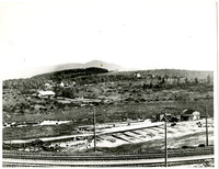 Building with railroad tracks in the foreground and Chuckanut Mountain in the background (possibly Edgemoor before development)