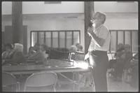 Unidentified man (probably Galen Biery) giving magic lantern presentation