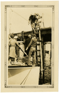 Women climb ladder to pier to disembarck from bow of ship