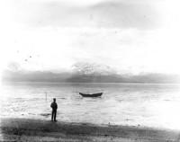 Unidentified man on tidal flats in Alaska