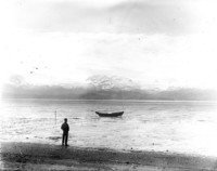Unidentified man on tidal flats in Alaska