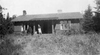 Woman on Porch of Viqueen Lodge