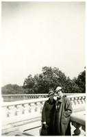 Two women pose at a memorial or landmark in Washington, D.C.