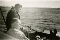 Two men on small boat fishing in Bellingham Bay