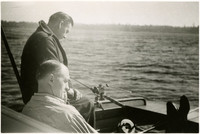 Two men on small boat fishing in Bellingham Bay