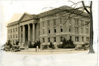 Exterior of Skagit County Courthouse with early model cars on snowy Kincaid Street