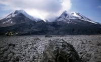 The crater, seen from the pyroclastic flow, with hardened lava in foreground.