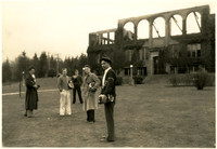 Five male students stand on front lawn of burned out Fairhaven High School, Bellingham, WA