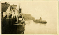 "Cannery tender ""Callendar"" tied to Pacific American Fisheries dock with fishing scow in background"