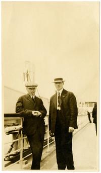 Two men on deck of passenger ship