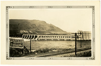 Downriver view of Rock Island Dam with railroad in foreground