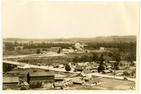 Aerial view of semi-rural neighborhood, Bellingham, Washington, with Northwest Avenue bisecting the foreground and coal mining operation in distance