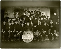 """Youth marching band poses with """"Bellingham Y.M.C.A. Washington"""" on drum in center"""