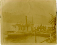 Horses tied up on lake dock next to small steam vessel with coal shutes at right, near Blue Canyon, Lake Whatcom, Washington