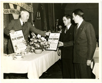 John Kellogg and Wally Armstrong receive Bellingham Community and War Chest Blue Ribbon