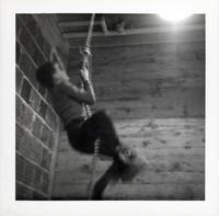 1965 Boy Climbing Rope