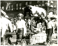 Children in pirate costume carry a litter with young girl in Tulip Festival Parade, Bellingham, WA, 1929