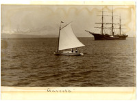 Small sailing skiff at center, with three-masted sailing vessel in background
