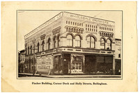 The Fisher Building, a tthree-story commercial building in downtown Bellingham, WA, with arched upper windows, and Graham & Munch Drug Co. occupants