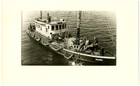 The Canadian government steamer, Quadra, with piles of ropes and tarps with several crewmen on deck