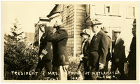 President and Mrs. Harding walk with guards at Metlakatla, Alaska
