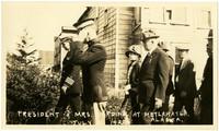 President and Mrs. Harding walk with guards at Metlakatla, Alaska