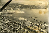 Aerial view of entire Bellingham, WA, waterfront showing marina, warehouses, and surrounding neighborhoods