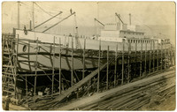 """A the large Pacific American Fisheries steamship """"Redwood"""" under construction in drydock"""