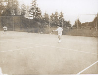 Two People Playing Tennis