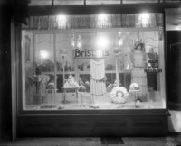 "Front display window of ""Brisbin's Millinery"""