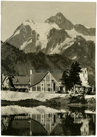 View across pond of Mt. Baker Lodge with Mt. Shuksan in background