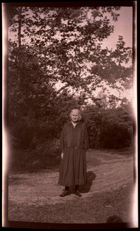 Unidentified older woman in black dress