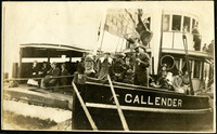 """Ferry passengers seen on forward deck of the """"Callender"""" as it is under tow; another ferry vessel seen starboard side adjacent"""