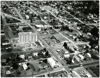 Aerial view of Bellingham, Washington, with large, multi-story building under construction