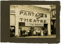 Small crowd posing in front of Pantages Theater