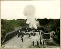 Soldiers man cannons as mortar is fired at Fort Casey, Whidbey Island, Washington