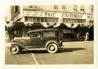 A car drives down street in front of The Fairway Market, Bellingham, Washington