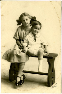 Mary Grace and Richard Frieday Everett - Girl and little boy sit on bench for portrait