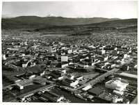 Aerial view of downtown Bellingham, WA, from waterfront looking east towards Mt. Baker