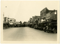 A crowd gathers in middle of car-lined main street of Lynden, Washington