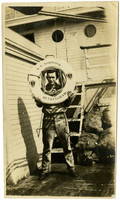 Man poses with life ring on deck of Pacific American Fisheries SS Norwood of Bellingham, WA