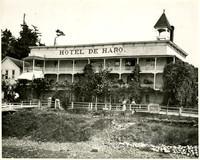 Several people wander along boardwalk in front of Hotel de Haro, Roche Harbor, San Juan Island
